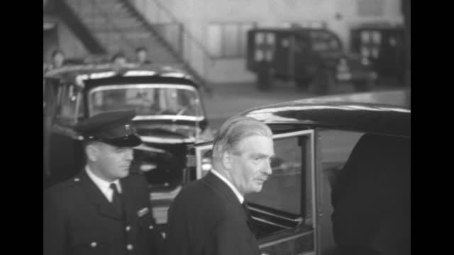 slightly high angle shot three men pose for photo opportunity outdoors; man at center is british foreign secretary anthony eden; man at right might... - looking at camera stock videos & royalty-free footage