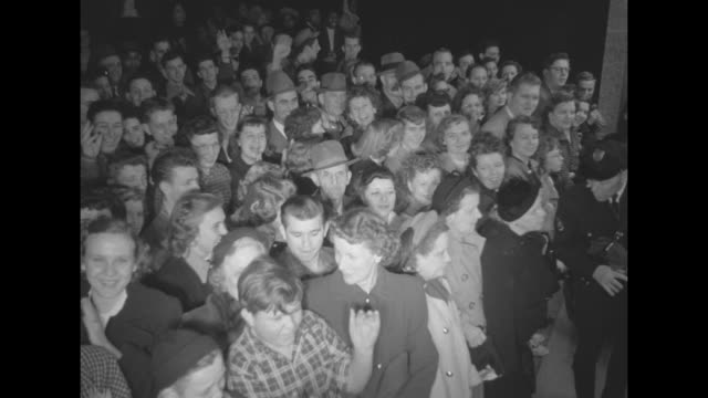 spectators outside theater applaud / ornamentation on wall inside Tennessee Theatre / tiltdown shot theatergoers in theater lobby / WS line of...