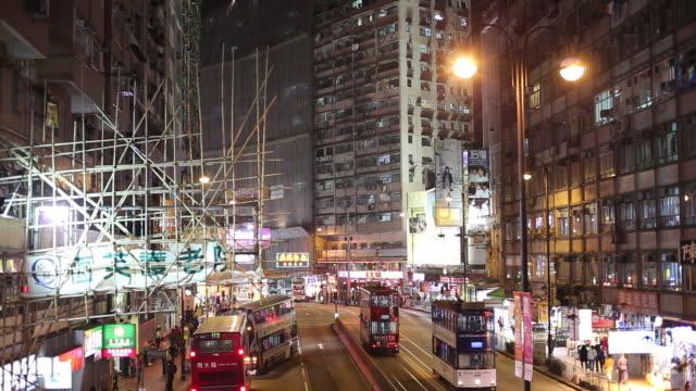 WS HA Night street scene with bus and tram traffic / Hong Kong, China