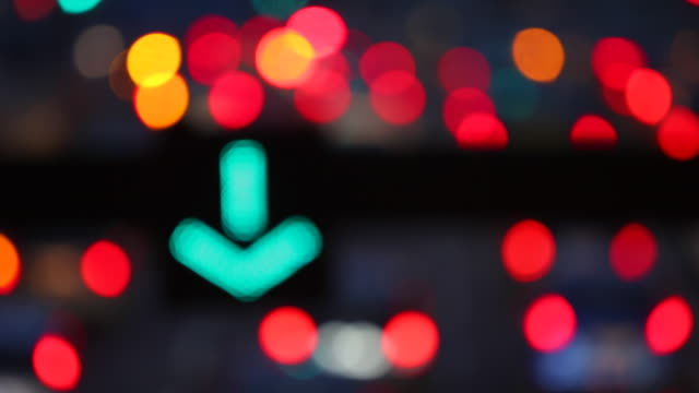 Night Street Szene with a green traffic arrow sign, Cars, Lights and Bokeh