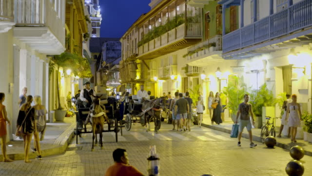 night streetlife with tourists in cartagena - colombia stock videos & royalty-free footage