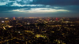 night sunset illuminated milan cityscape aerial panorama 4k time lapse italy