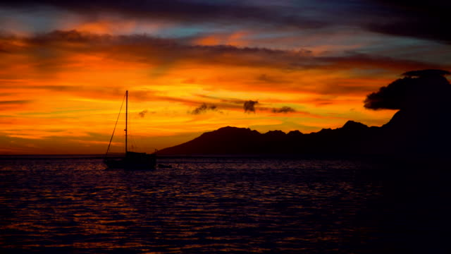 Night sunset over Moorea Island from Tahiti Pacific