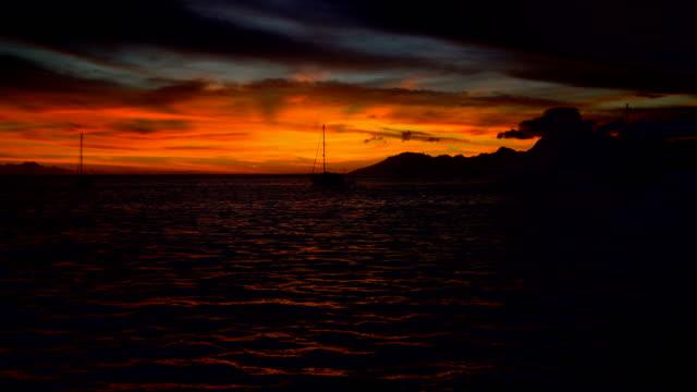 Night sunset over Moorea Island from Tahiti Pacific