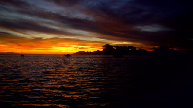 night sunset over moorea island from tahiti pacific - polynesian ethnicity stock videos & royalty-free footage