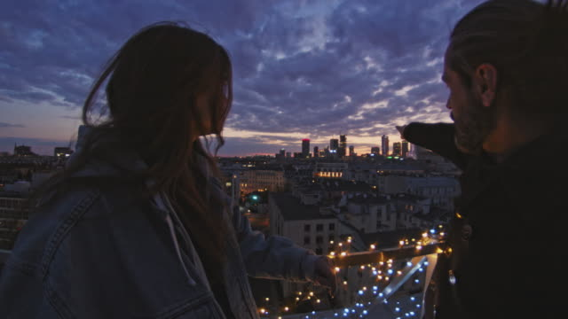 night talks on the rooftop. city after sunset - gossip stock videos & royalty-free footage