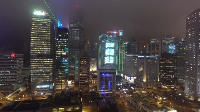 night time aerial of the daily light show on hong kong island. a symphony of lights he nightly multimedia show involving more than 40 buildings on... - hong kong island stock videos & royalty-free footage