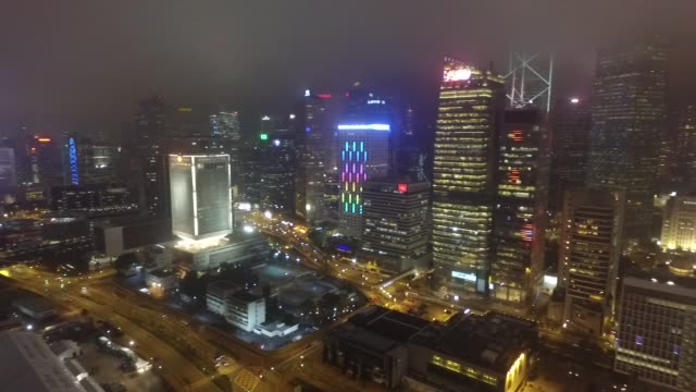 night time aerial of the daily light show on hong kong island. a symphony of lights is the nightly multimedia show involving more than 40 buildings... - hong kong island stock videos & royalty-free footage