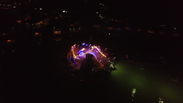 vidéos et rushes de night time aerial view of party social scene held at a cable wakeboarding park at kite cable thailand, pranburi - constellation