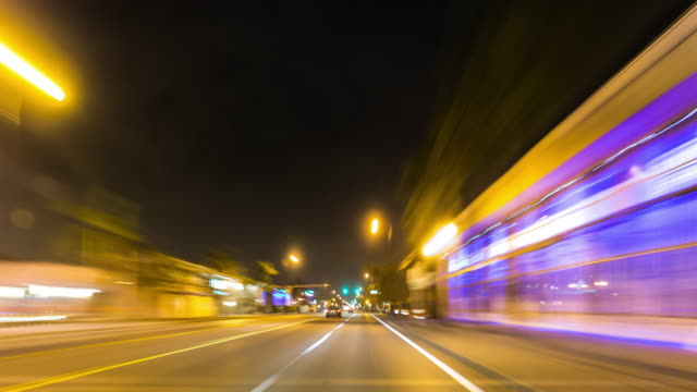 Night time car traffic time lapse. Driving through Miami streets, Florida. USA