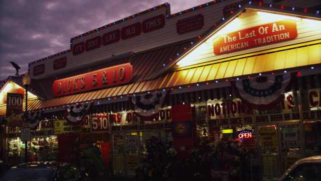 """night time exterior of old-time dime store, """"dicks 5 & 10"""" - discount shop stock videos & royalty-free footage"""