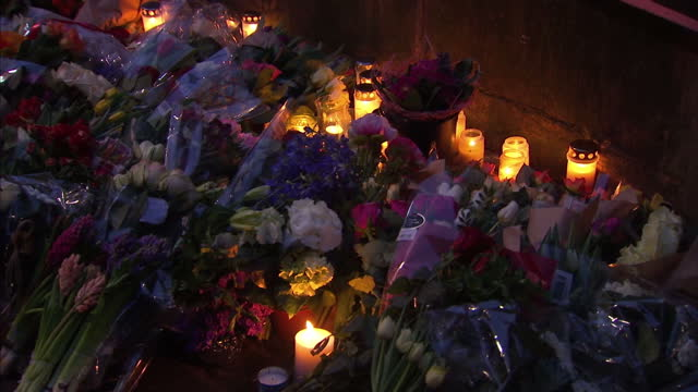 night time exteriors showing candles and messages left following the attacks in copenhagen on february 15 2015 in copenhagen denmark - terrorism stock videos & royalty-free footage