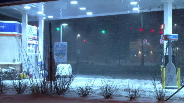 Night time heavy snow and blizzard conditions in Suffolk County Long Island during the height of a snowstorm