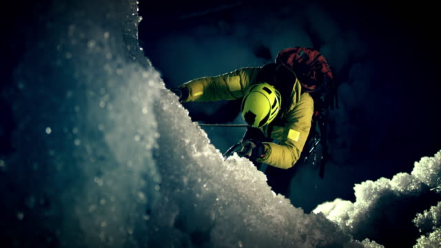night time ice slope ascending - sfida video stock e b–roll