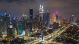 night time illumination kuala lumpur downtown traffic road jam aerial panorama 4k timelapse malaysia