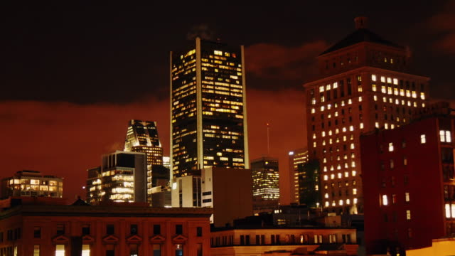 night time lapse looking at downtown district from old town montréal - vieux montréal stock-videos und b-roll-filmmaterial
