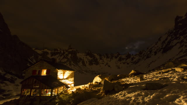 Night time lapse of a mountain hut