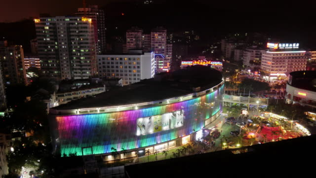 night time lapse of illuminated shopping mall in sanya, hainan province, china. view from above - spoonfilm stock-videos und b-roll-filmmaterial