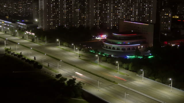 night time lapse of traffic on kwangbok st. at night. pyongyang, north korea, dprk - spoonfilm stock videos and b-roll footage