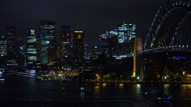 night time lapse sydney business district illuminated buildings - bridge built structure stock videos & royalty-free footage