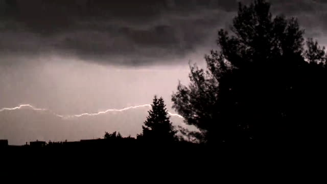 Night Time Lightning Over A Residential Neighborhood