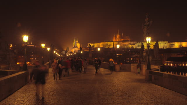 night time on charles bridge prague - charles bridge stock videos & royalty-free footage