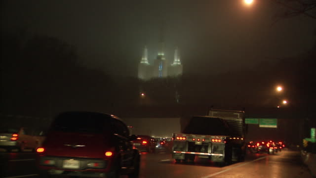 ws night time traffic on i-495 with illuminated mormon temple in background in kensington, maryland, a suburb of washington, d.c. - mormonism stock videos & royalty-free footage
