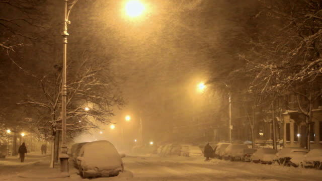 night time view of a street in the snow, illuminated by street lights - 30 seconds or greater stock videos & royalty-free footage