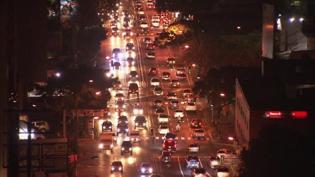 WS HA ZO Night time view of traffic in streets and twinkling lights in distant hills / Metropolitan District of Caracas, Miranda, Venezuela