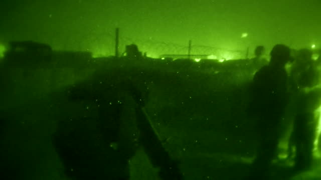 night time views of us marines firing at enemy targets in helmand province afghanistan - afghanistan stock videos & royalty-free footage