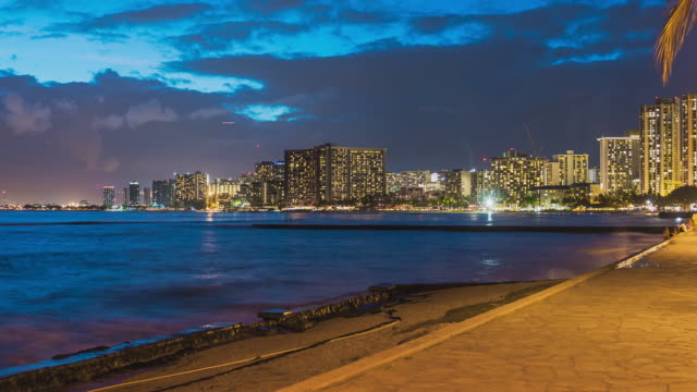 stockvideo's en b-roll-footage met t/l night timelapse in waikiki, honolulu, oahu, hawaii - weekly fireworks at the hilton - oahu