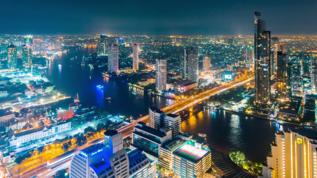Night timelapse of Bangkok city downtown with Chao Phraya river, Thailand