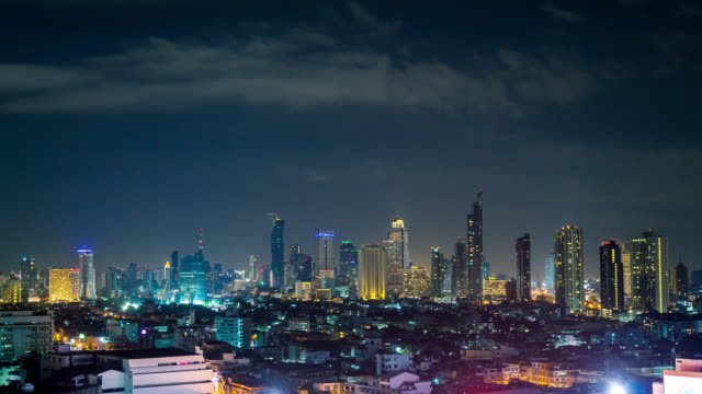 Night timelapse of Bangkok downtown with skyscrappers, Thailand
