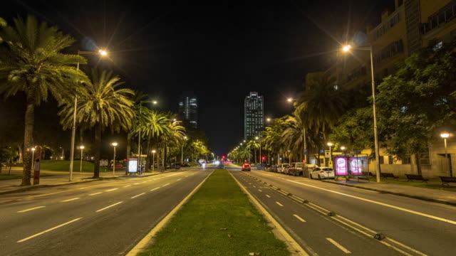 Night Timelapse of Barcelona city traffic, Hotel Arts and Mapfre tower