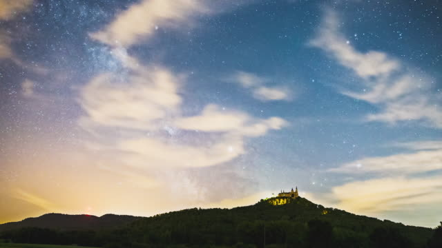 t/l night timelapse of castle hohenzollern and the milkyway behind it. wide shot - fantasy video stock e b–roll