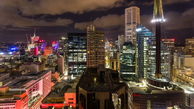 Night Timelapse of Sydney skyline with the Harbour Bridge from elevated view in 4K