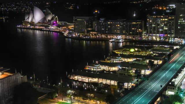 Night Timelapse of Sydney with the Opera House and traffic from an elevated view