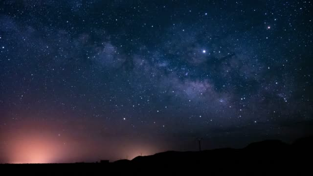 night timelapse of the milkyway and the dunes in the desert - star field stock videos & royalty-free footage