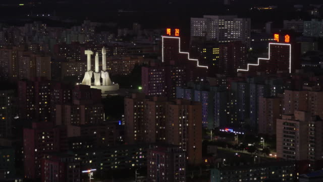 night time-lapse of the workers monument in pyongyang, north korea, drpk. medium shot from juche tower - spoonfilm stock videos and b-roll footage
