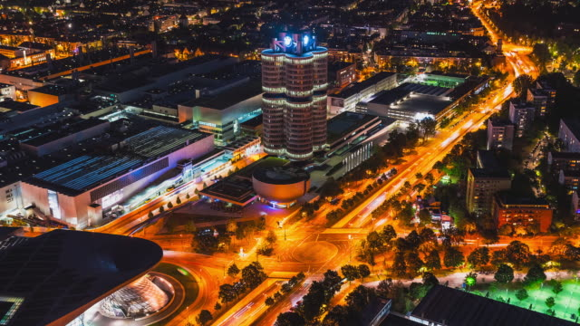 T/L night timelapse overlooking the street crossing in front of the BMW Cylinder and BMW World