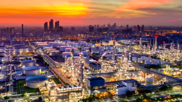 Night to Day 4K Timelapse or Hyperlapse of Aerial of industrial park with oil refinery and storage tank in Asia at Sunrise