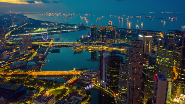 night to day hyperlapse or dronelapse scene of singapore business district downtown at sunrise - hd format stock videos & royalty-free footage