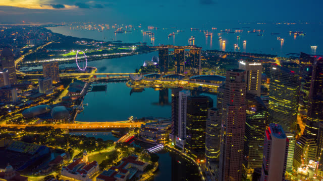 night to day hyperlapse or dronelapse scene of singapore business district downtown at sunrise - singapore stock videos & royalty-free footage