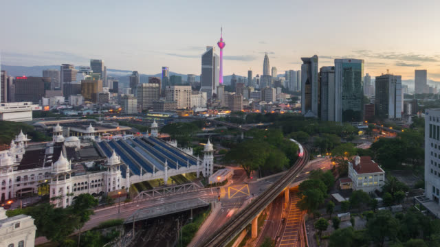 night to day sunrise at kuala lumpur city - elevated road stock videos & royalty-free footage