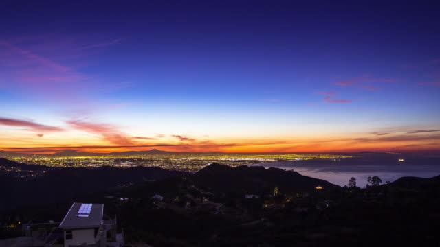 night to day sunrise time lapse of los angeles from saddle peak, malibu - malibu stock videos & royalty-free footage