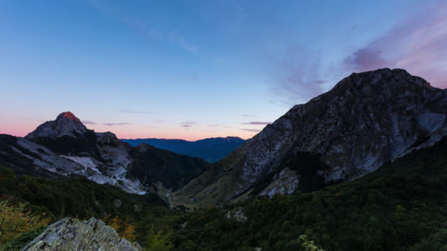 LUCCA - CIRCA 2015: Night to Day Sunrise Time Lapse of the Apuane Alps