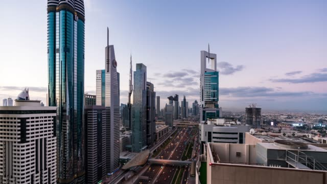 night to day /time lapse aerial view of traffic in dubai - level stock videos and b-roll footage