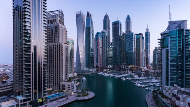 night to day /time lapse modern skycrapers in dubai marina - yacht stock videos & royalty-free footage