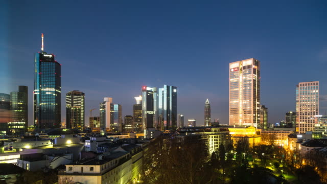 a night to day time lapse of central frankfurt am main, germany, featuring a moonset occasionally obscured behind thin, wispy clouds - filiz stock videos & royalty-free footage