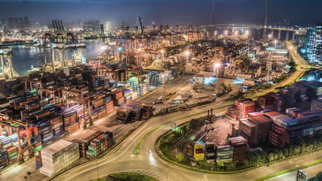 vídeos de stock, filmes e b-roll de night to day time lapse of hong kong's commercial container port - time lapse da noite para o dia